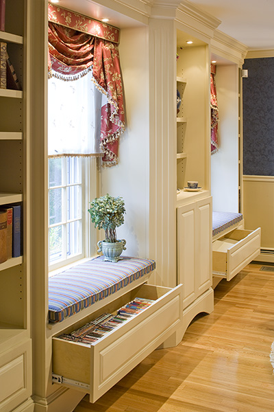 Built-in cabinetry in this media room created Traditional Interior Design