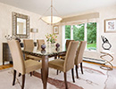 This design of this dining room minimizes the use of hard edged geometrics while maintaining the luxurious but never overstated beauty of contemporary interior design