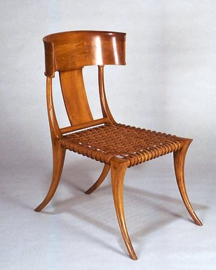Klismos chair with a mid-century modern aesthetic