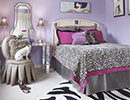 This example of contemporary interior design is the bedroom of a young girl that uses a zebra pattern rug and bedding to fantastic effect.