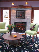 Fireplace with raw marble surround by Boston Design and Interiors, Inc.